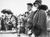 Picture relating to Manuka - titled 'Reverend Doctor William John Edwards, Headmaster of Canberra Grammar School with Lady Stonehaven, wife of the Govenor General with trophies for the School Sports Day at Manuka Oval.'