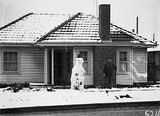 Picture relating to Ainslie - titled 'Record fall of snow - House with snowman in Ainslie'