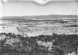 Picture relating to Ainslie - titled 'View from Mt Ainslie along Anzac Parade and Reid to Old Parliament House'