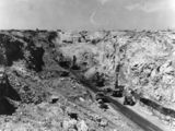 Picture relating to Moura - titled 'Dredgers and trucks in the opencut mine at Moura, Queensland, 1962'