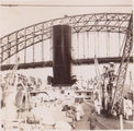 Picture relating to Sydney - titled 'Sydney, Ship about to go under The Sydney Harbour  Bridge - 1940's'