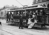 Picture relating to Brisbane - titled 'Woman getting on a tram, Brisbane, 1910-1920'