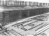Picture relating to Manuka - titled 'Manuka swimming pool under construction, wall reinforcement being installed, Manuka Circle, Kingston.'