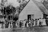 Picture relating to Gympie - titled 'Students and teachers outside the first Grammar School, Gympie, ca. 1902'