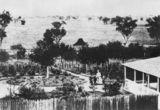 Picture relating to Jimbour - titled 'Jimbour Station's main bluestone house and gardens, ca. 1868'
