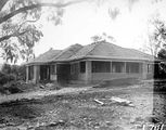 Picture relating to Acton - titled 'Weatherboard cottage under construction, Balmain Crescent, Acton.'