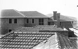 Picture relating to Acton - titled 'Detail of Hotel Acton roof, Edinburgh Avenue Acton, under construction.'