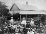 Picture relating to Gympie - titled 'Family in a garden at Gympie, Queensland, ca. 1903'