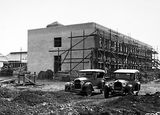 Picture relating to Black Mountain - titled 'CSIR Laboratory Building with Insectarium on the left, Clunies Ross Street, Black Mountain, approaching completion, with motor cars.'