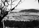 Picture relating to Reid - titled 'Reid and Braddon from Mount Ainslie, Ainslie Hotel and Civic buildings on left.'
