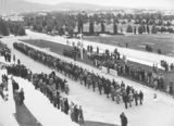 Picture relating to Parliament House - titled 'Anzac Day 1933. Returned Servicemen marching past the Govenor General, Sir Isaac Isaacs, in front of Old Parliament House.'