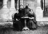 Picture of / about 'Jimbour' Queensland - Jenner family gathered around a table in the yard, Jimbour