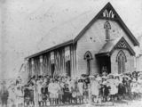 Picture relating to Cloncurry - titled 'Congregation gathered together outside the Catholic Church at Cloncurry about 1910'