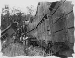 Picture relating to Eudlo - titled 'Group of workers are attending to a derailed railway carriage at Eudlo, 1914'