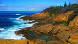 Picture relating to Bermagui - titled 'Rugged rocky, cliffy coastline at the back of Bermagui'
