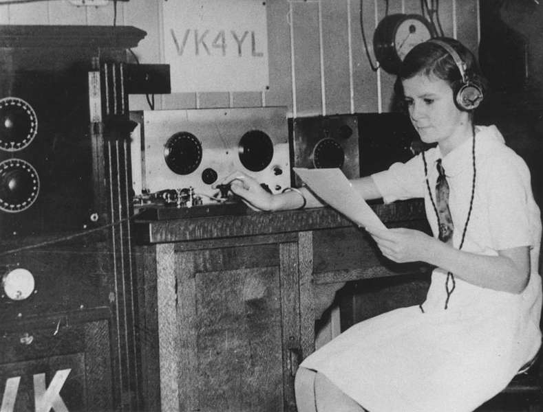 Picture of / about 'Wynnum' Queensland - Twelve year old Madeleine Pugh operating a radio in her home at Wynnum, Brisbane, 1934