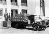 Picture relating to Parliament House - titled 'Arrival of National Library books at Old Parliament House on a White truck - People include Harold L White and K Binns'