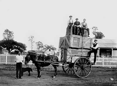 Picture of / about 'Mareeba' Queensland - Men, possibly staff from D. G. Brims' joinery works, sitting atop a loaded horsedrawn wagon at Mareeba