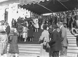 Picture relating to Parliament House - titled 'Royal Visit, May 1927 - Canberra citizens passing the Duke and Dutchess of York on the steps of Old Parliament House at the Civic Reception.'