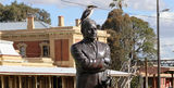 Picture relating to Junee - titled 'Ray Warren statue Junee'
