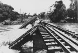Picture relating to Burdekin River - titled 'Flood damaged railway bridge over the Burdekin River, 1917'
