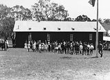 Picture relating to Russell - titled 'School building with children and crowd at the opening of Mount Russell School'