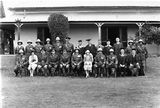 Picture relating to Duntroon - titled 'Royal Visit, May 1927 - The Duke and Duchess of York with the staff of Duntroon Royal Military College in front of the Officers Mess, Duntroon House.'