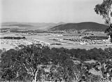 Picture relating to Reid - titled 'Reid, Braddon and Civic Centre from Mt Ainslie. Ainslie Hotel, Limestone Avenue on right, Black Mountain at the rear.'
