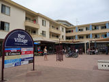 Picture relating to Shoal Bay - titled 'Shoal Bay Village Shopping Complex'