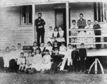 Picture relating to Boulia - titled 'Teacher and pupils at Boulia State School, ca. 1890'