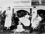 Picture relating to Queensland - titled 'Family having tea in a garden, 1910-1920'