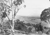 Picture relating to Parliament House - titled 'Anzac Parade, St John's Church and Old Parliament House from Mt Ainslie.'