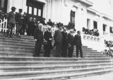 Picture relating to Parliament House - titled 'Anzac Day 1933, Prime Minister Hon J. A. Lyons, Leader of the Opposition, Hon J. A. Scullin and members on front steps of Old Parliament House.'