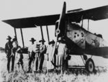 Picture relating to Queensland - titled 'Gathering in front of a biplane, 1920s'