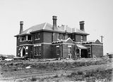 Picture relating to State Circle - titled 'St Andrew's House, State Circle, Forrest from the north east - Under construction - Completed October 1928.'