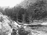 Picture relating to Cotter River - titled 'Downstream from the Cotter Dam wall and stilling pond to the Cotter River'