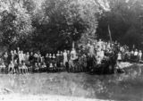 Picture relating to Gympie - titled 'School children from One Mile State School on a picnic at Gympie, Queensland, ca. 1906'