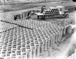 Picture relating to Kingston - titled 'Concrete pipes being loaded on a motor truck at Kingston yards'