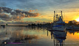 Picture relating to Tin Can Bay - titled 'Tin Can Bay - Golden Trawler Sunrise.'