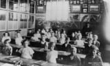 Picture relating to Rosewood - titled 'Children inside a classroom at the Rosewood State School, Rosewood, Queensland, ca.1929'