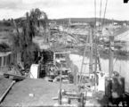 Picture relating to Canberra - titled 'Excavation workings - Sewerage mains, under the Molonglo River. Hotel Canberra (background) and Commonwealth Bridge (right).'