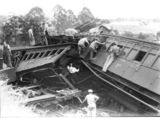 Picture of / about 'Camp Mountain' Queensland - Relief workers inspect smashed carriages after railway accident at Camp Mountain, Queensland, 1947
