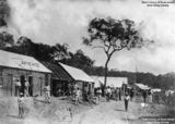 Picture relating to Cooktown - titled 'Men congregated on Charlotte Street, Cooktown, Queensland, ca. 1874'